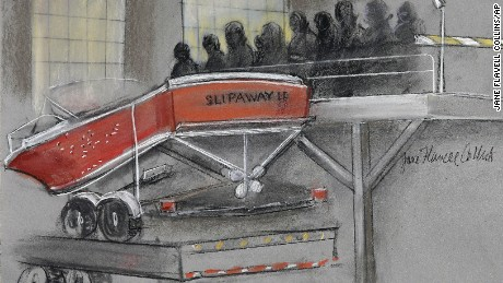 In this courtroom sketch, the boat in which Dzhokhar Tsarnaev was captured is depicted on a trailer for observation during Tsarnaev's federal death penalty trial Monday, March 16, 2015, in Boston. Tsarnaev is charged with conspiring with his brother to place two bombs near the Boston Marathon finish line in April 2013, killing three and injuring more than 260 people.