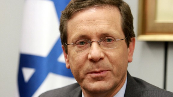Caption:Israeli Labour Party leader and co-leader of the Zionist Union coalition, Isaac Herzog, speaks with citizens as he campaigns on the eve of Israel