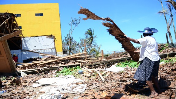 Residents clean up debris in Port Vila on Tuesday, March 17.