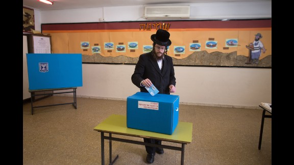An ultra-Orthodox Jewish man casts his ballot at a Jerusalem polling station on March 17.
