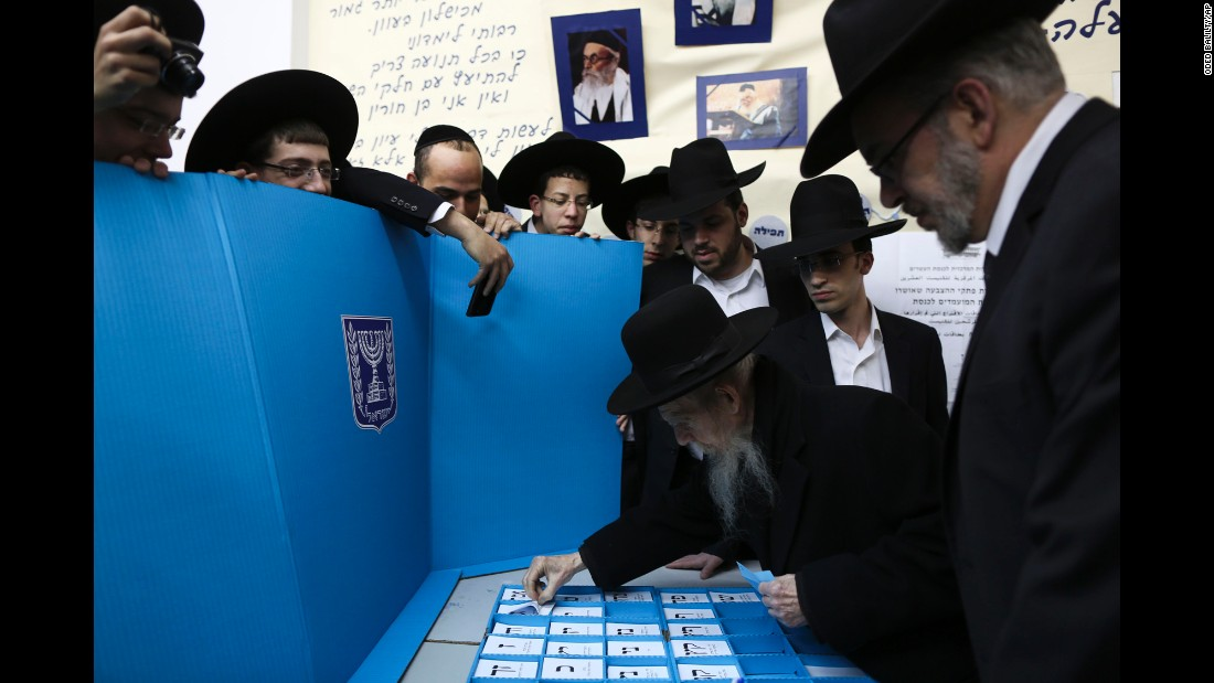 Rabbi Gershon Edelstein, center, prepares to vote in Bnei Brak, Israel, on March 17.