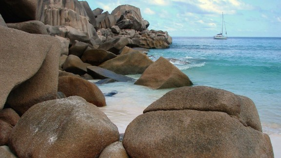 "Made up of about 115 islands in the western Indian Ocean, the Seychelles are fascinating to geologists because some of the islands are composed of granite rock. ""Those polished granite rocks are what give these islands that unique look,"" said iReporter Rob MacRiner. The sailboat MacRiner was skippering is anchored in the distance."