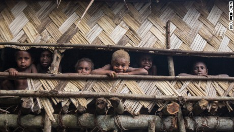 Children gather in a tree house last November, months before cyclone.