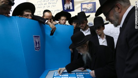 Ultra orthodox Jewish rabbi Gershon Edelstein prepares to vote in Bnei Brak, Israel, Tuesday, March 17, 2015. Israelis are voting in early parliament elections following a campaign focused on economic issues such as the high cost of living, rather than fears of a nuclear Iran or the Israeli-Arab conflict.