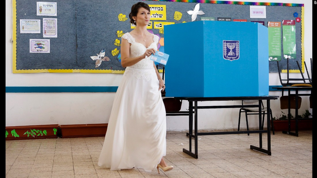 An Israeli bride prepares to cast her vote at a polling station in Holon, Israel, on March 17.