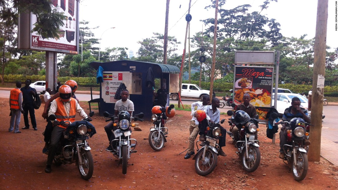 The SafeBodas standout from standard boda drivers through their high visibility jackets and helmets.