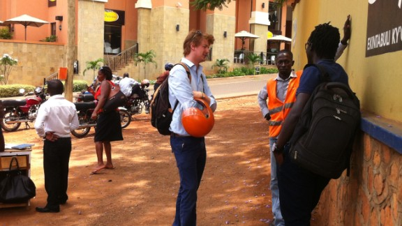 The Start-up is run by Alastair Sussock (left) and Ricky Rapa Thomson (right) whose goal is to professionalize transport first in Kampala then across Uganda and other African countries using boda bodas. They are pictured here talking to a driver on his patch in Kisementi.