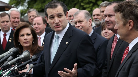 Cruz speaks as then-Rep. Michele Bachmann (left), Sen. Mike Lee (second right) and Sen. Rand Paul (right) listen during a news conference May 16, 2013, on Capitol Hill.