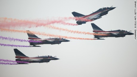 J-10 fighter jets perform at the Airshow China 2014 in Zhuhai, south China's Guangdong province on November 12, 2014.