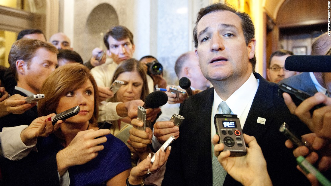 Cruz speaks to reporters on September 25, 2013, after ending his talk-a-thon on the floor of the US Senate in Washington, D.C.