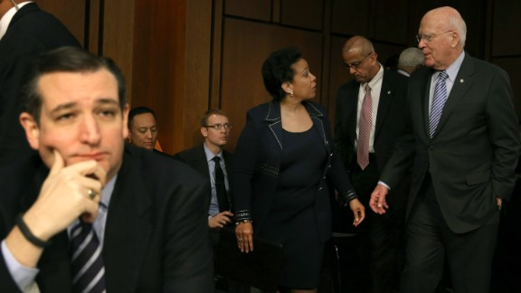 Sen. Patrick Leahy (right) escorts Loretta Lynch back from a lunch break as Cruz  (left) sits nearby during her confirmation hearing before the Senate Judiciary Committee January 28, 2015, on Capitol Hill.