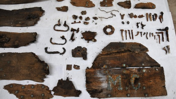 """The initials """"M.C."""" are seen on a plank of a coffin that was found in a crypt beneath the Convent of the Barefoot Trinitarians."""