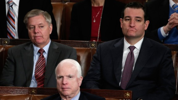 From left, U.S. Sens. Lindsey Graham, John McCain and Cruz listen as President Barack Obama delivers his State of the Union address in January 2014.