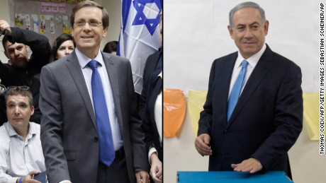 Israeli Labour Party leader and co-leader of the Zionist Union list for the upcoming general election, Isaac Herzog (L), casts his ballot near his wife Michal (C), in Tel Aviv on March 17, 2015.  Voting polls opened for unpredictable elections to determine whether Israelis still want incumbent Prime Minister Benjamin Netanyahu as leader, or will seek change after six years.  AFP PHOTO / THOMAS COEX        (Photo credit should read THOMAS COEX/AFP/Getty Images)  Israeli Prime Minister Benjamin Netanyahu casts his vote during Israel's parliamentary elections in Jerusalem, Tuesday, Mar. 17, 2015. Israelis are voting in early parliament elections following a campaign focused on economic issues such as the high cost of living, rather than fears of a nuclear Iran or the Israeli-Arab conflict. (AP Photo/Sebastian Scheiner, Pool)