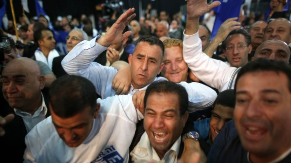 Likud supporters celebrate in Tel Aviv after some exit poll results were announced Tuesday, March 17.