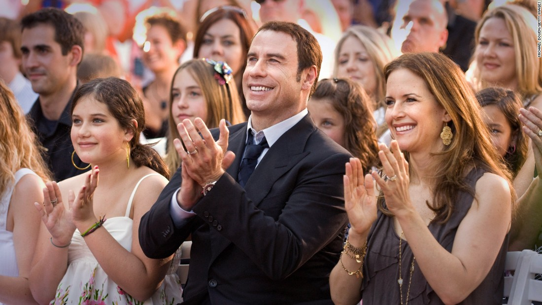 Actor John Travolta and his wife, actress Kelly Preston, attend the opening of a Scientology Mission in Ocala, Florida, in May 2011.