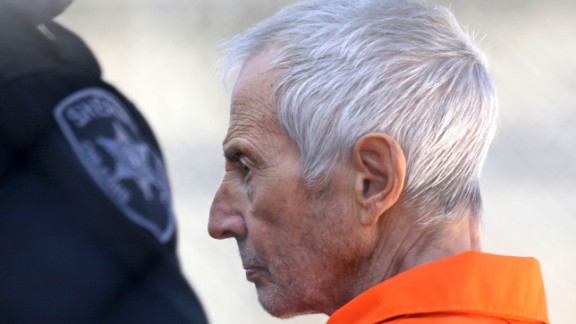 Robert Durst is escorted into Orleans Parish Prison after his arraignment in Orleans Parish Criminal District Court in New Orleans, Tuesday, March 17, 2015.  Durst was rebooked on charges of being a convicted felon in possession of a firearm, and possession of a weapon with a controlled dangerous substance.   (AP Photo/Gerald Herbert)