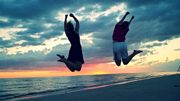 "Corinna Morse, left, spent time with her family in March in Fort Myers Beach, ""where the sunsets have you leaping for joy!"" The town is on Estero Island on the Gulf Coast of southwest Florida."