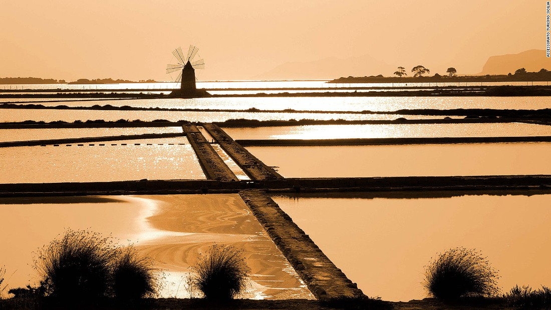 "Known for its sweet wine-producing vineyards and salt pools, Marsala's name comes from the Arabic ""Marsa Allah,"" meaning God's harbor. <br />Surrounded by an archipelago of small islands, the lagoon boasts a Phoenician vessel and settlement. <br />It's dotted with ancient windmills and often sees spectacular sunsets.<em><br />Strada Provinciale 21, Marsala, Trapani</em>"