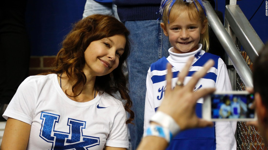 Ashley Judd attends a basketball game at her alma mater, the University of Kentucky, where she got an undergraduate degree in French. She later completed a master's degree in public administration at Harvard's John F. Kennedy School of Government.