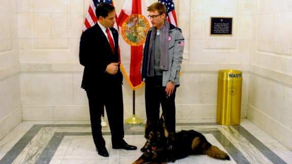 Paralympian Brad Snyder poses with Rubio during a Team USA Congressional visit in November 2013.