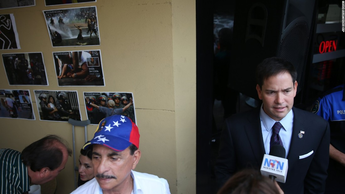 Rubio speaks to the media at the Doral restaurant in April 2014.