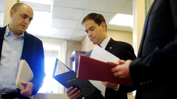 Rubio talks to aides in December before speaking on President Barack Obama