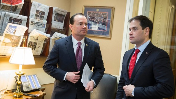 Sen. Mike Lee (R-Utah) (left) and Sen. Marco Rubio (R-FL) talk before a news conference to introduce their proposal for an overhaul of the tax code, March 4, 2015 on Capitol Hill in Washington, D.C.