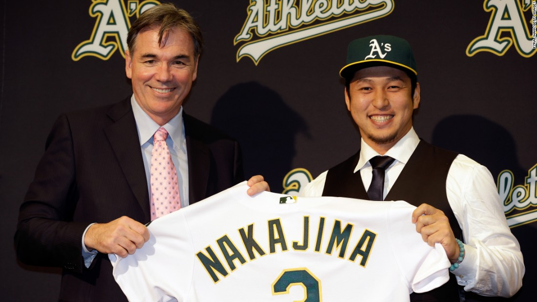 Oakland Athletics general manager Billy Beane -- famous for signing players on a budget -- introduces Hiroyuki Nakajima of Japan to the Oakland Athletics at the O.co Coliseum on December 18, 2012 in Oakland, California.