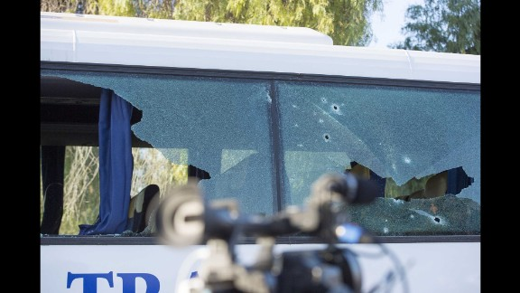 Bullet holes are seen in a bus window near the museum.