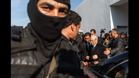 Tunisian President Beji Caid Essebsi leaves a Tunis hospital after visiting those injured in the attack.