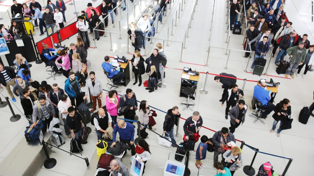 Passengers at a security checkpoint in John F. Kennedy International Airport in New York. The Transportation Security Administration has a program called SPOT that lets behavior detection officers screen passengers' facial expressions for potential malicious intent.
