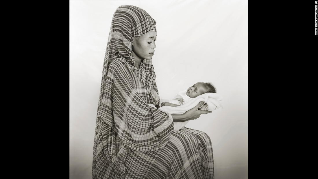 Johahir Zakaria, 17, holds her baby daughter.