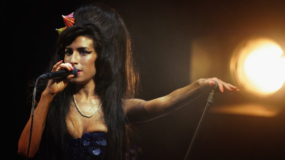 """British songstress Amy Winehouse was found dead in her London home in July 2011. She was 27. The soulful singer, who openly struggled with <a href=""""http://marquee.blogs.cnn.com/2011/09/12/mitch-winehouse-amy-hadnt-done-drugs-in-three-years/?iref=allsearch"""" target=""""_blank"""">drug and alcohol abuse</a> during her career, <a href=""""http://www.cnn.com/2013/01/08/showbiz/uk-amy-winehouse-inquest/index.html?iref=allsearch"""" target=""""_blank"""">died of accidental alcohol poisoning</a>, a finding that sparked a global <a href=""""http://www.cnn.com/2011/OPINION/07/27/danovitch.winehouse.addiction/index.html?iref=allsearch"""" target=""""_blank"""">conversation</a> <a href=""""http://www.cnn.com/2011/SHOWBIZ/Music/07/25/winehouse.death.reaction/index.html?iref=allsearch"""" target=""""_blank"""">on the nature</a> of substance abuse and its treatment. """"Amy,"""" a documentary on her life, was released in 2015."""