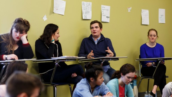 """James Barringer, center, started Boys and Men for the ERA and is part of his school's feminism club. """"Everyone at some point has had a mother,"""" he says. """"We would want her to have equal rights."""""""