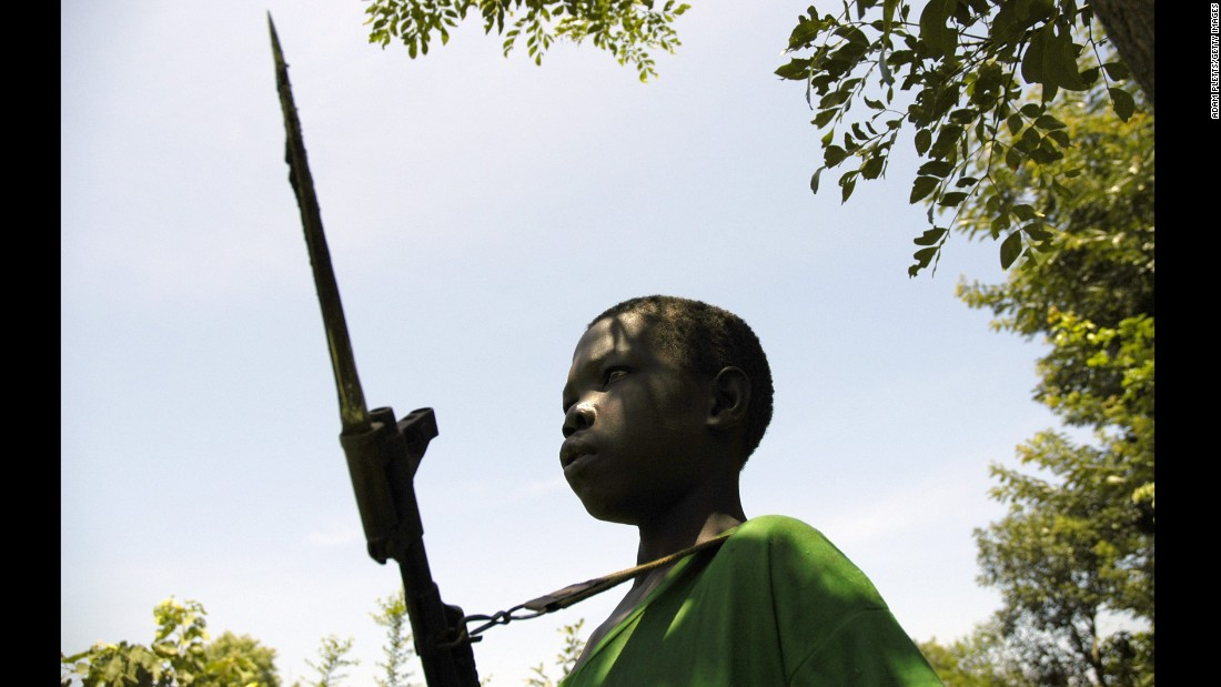 A young boy fighting for the Lord's Resistance Army stands guard in South Sudan as LRA leader Joseph Kony meets with the Southern Sudan vice president in July 2006.