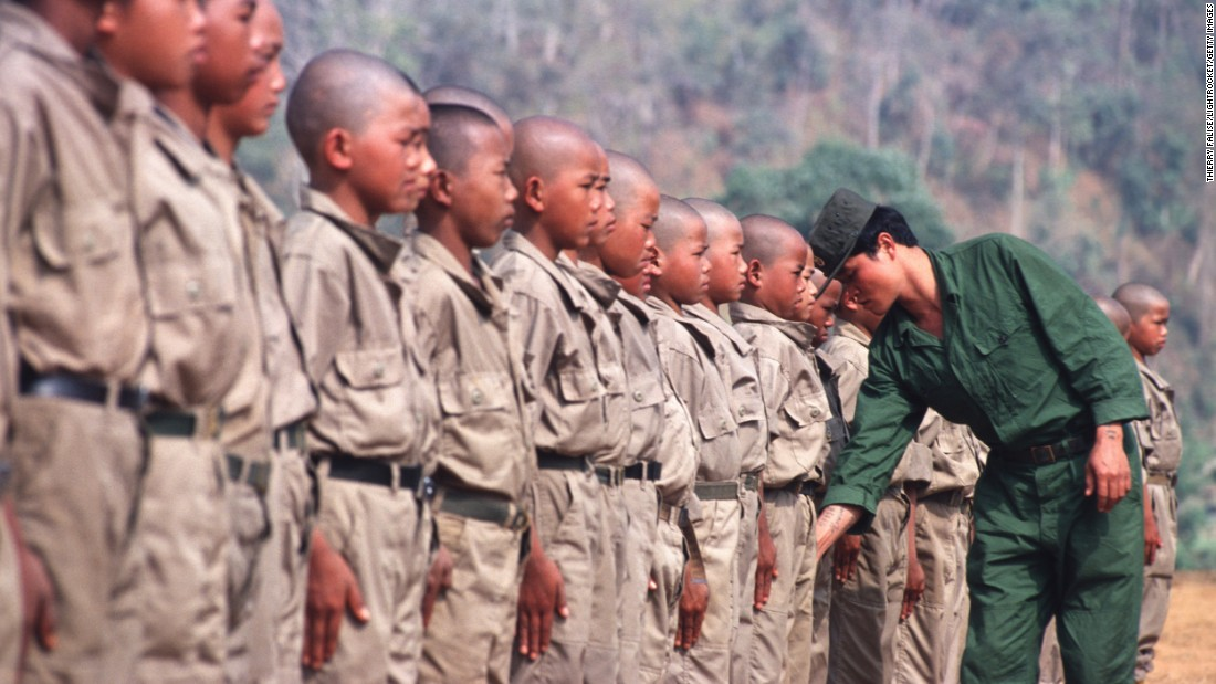 Child soldiers of the resistance Mong Tai Army during training with their commander in Myanmar in 2001.