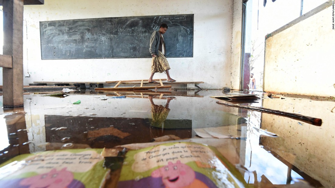 A child walks through a damaged classroom on Tanna Island on March 19.