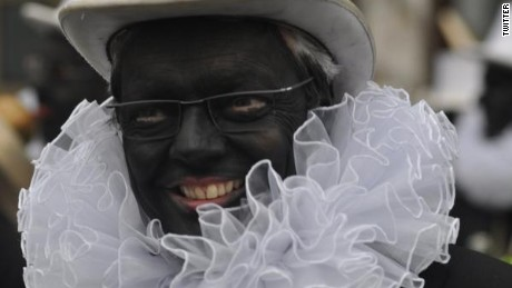 Belgian Foreign Minister Didier Reynders gives a TV interview while wearing blackface.