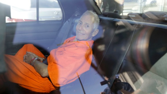 Robert Durst is transported from Orleans Parish Criminal District Court to the Orleans Parish Prison after his arraignment in New Orleans, Tuesday, March 17, 2015.  Durst was rebooked on charges of being a convicted felon in possession of a firearm, and possession of a weapon with a controlled dangerous substance.