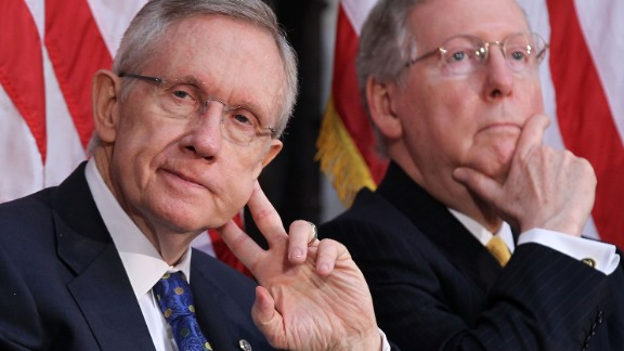 Senate Majority Leader Harry Reid, D-Nevada, and McConnell listen during a dedication ceremony of the statue of former President Gerald Ford at the Rotunda of the U.S. Capitol in May 2011.