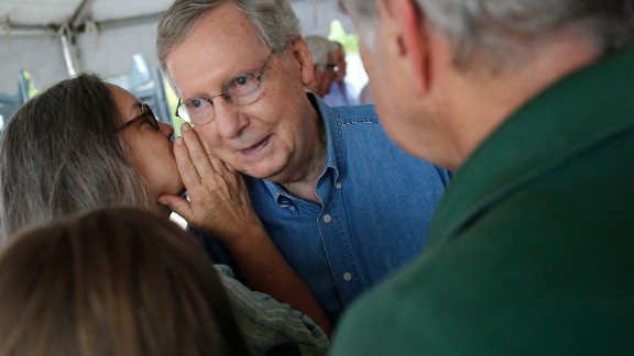 McConnell talks with supporters at a campaign rally in Hindman, Kentucky, during a two-day bus tour of the eastern part of the state in August 2014.