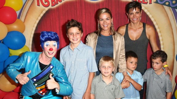 """Celebrity chef Cat Cora, center, and wife Jennifer Cora are shown here with their four sons at the 2014 premiere of Ringling Bros. and Barnum & Bailey's """"Legends"""" in Los Angeles."""