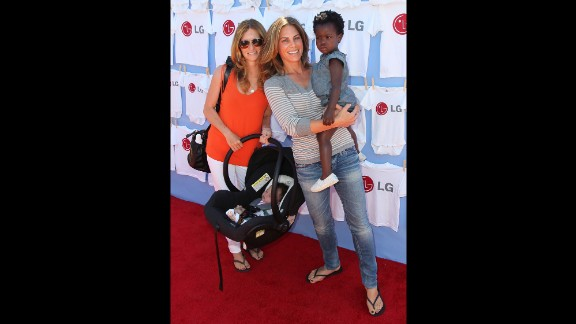 """""""Biggest Loser"""" trainer and television personality Jillian Michaels, center, partner Heidi Rhoades and their son Phoenix and daughter Lukensia attend a 2012 event in Beverly Hills."""
