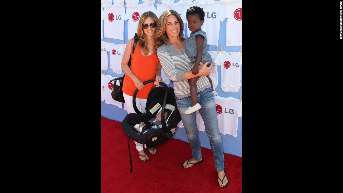 """Biggest Loser"" trainer and television personality Jillian Michaels, center, partner Heidi Rhoades and their son Phoenix and daughter Lukensia attend a 2012 event in Beverly Hills."