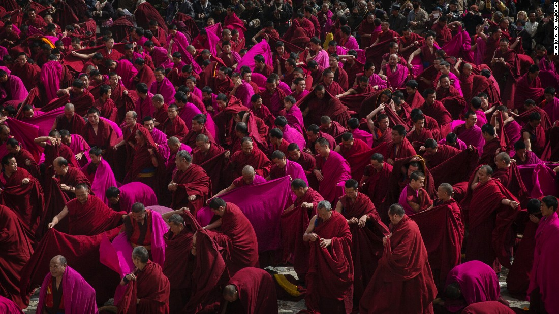 "Monks unfurl their robes during ""Great Prayer"" rituals on March 5, 2015. Labrang Monastery is one of the six great monasteries of the Gelug school of Tibetan Buddhism and one of the largest outside of the Tibetan Autonomous Region."