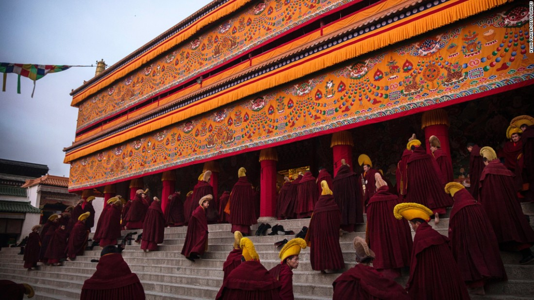 "Monks of the Gelug, Tibetan Buddhism's ""Yellow Hat"" order, arrive for morning prayers on March 3, 2015."