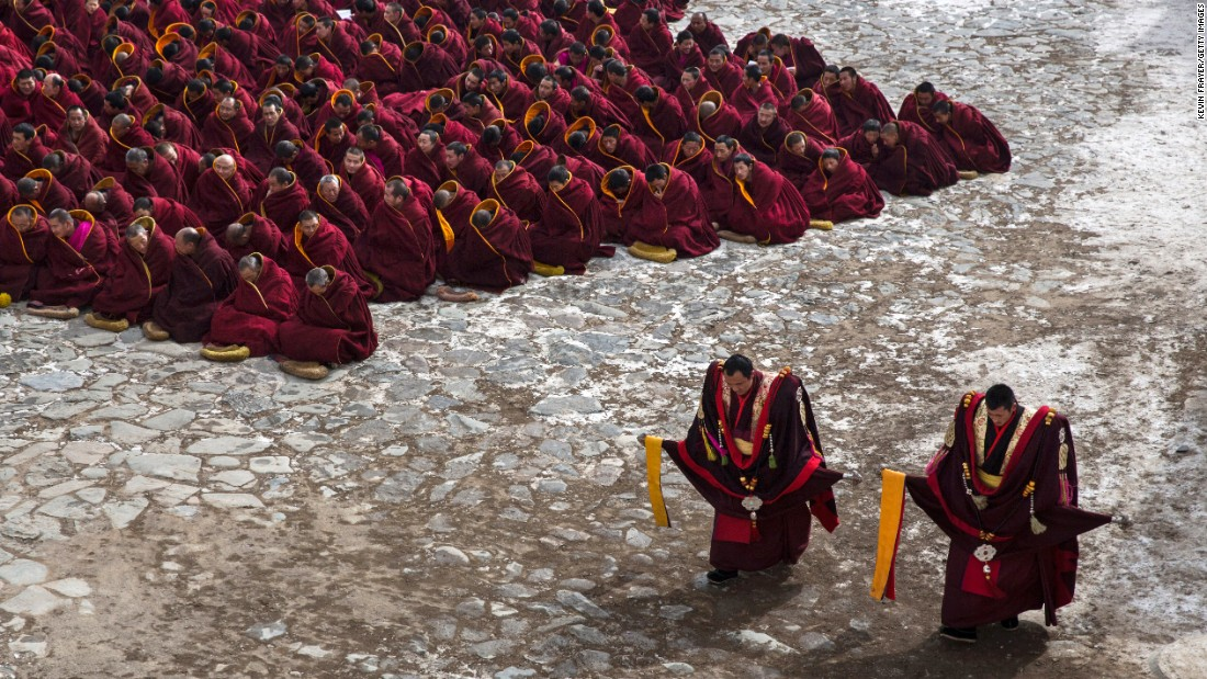 Tibetan Buddhist monks at Labrang Monastery sit on the ground during a special prayer on March 5, 2015.