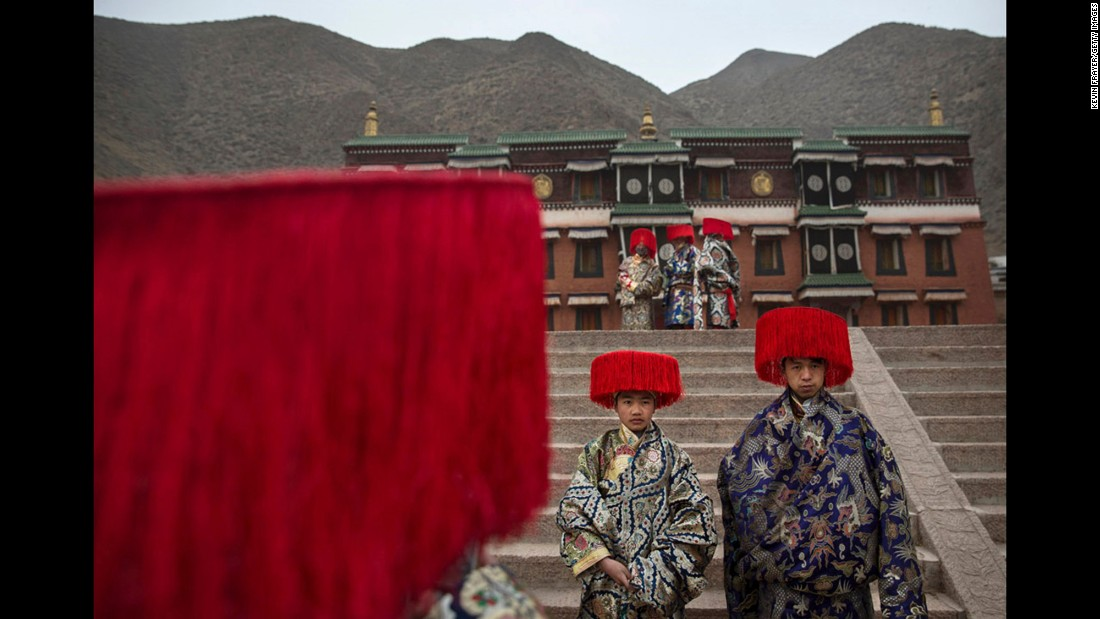 Tibetan Buddhists wear traditional clothing as they wait to take part in a procession at Labrang Monastery on March 4, 2015.