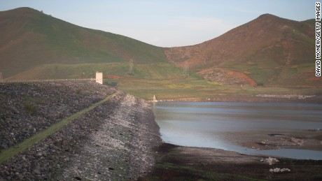 Low water is seen at the dam of Lake Success as rain totals remain insufficient to break the worsening drought on February 11, near East Porterville, California. Many local residents, whose water wells have run dry, fill their tanks with free non-potable water for flushing toilets, bathing and laundering and use bottled water for drinking and washing dishes. Many of the dry wells of 926 homes in Tulare County dried up last summer when some 17 California communities ran out of water.